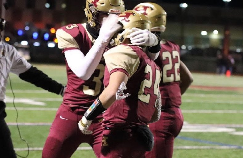 Junior+Sean+Levonaitis+%28No.+24%29+celebrates+his+touchdown+with+his+teammate+Matt+Michinard+during+their+game+against+Washington+Twp.