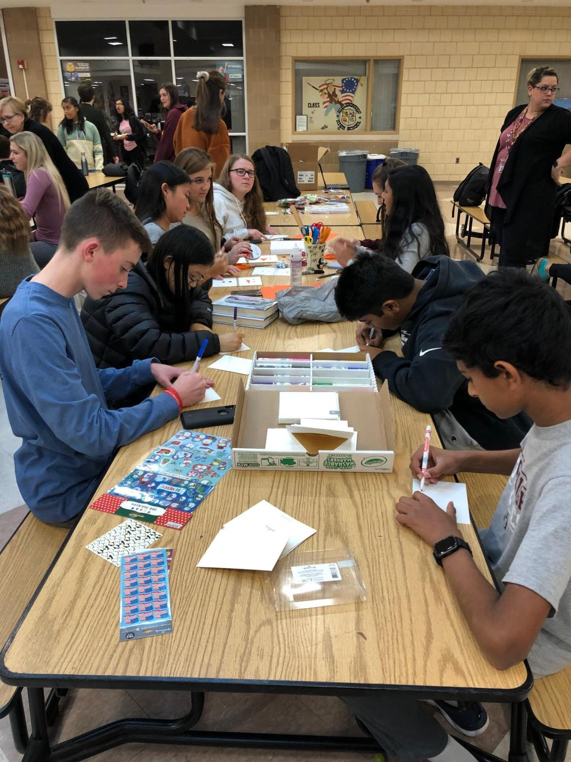 Students stay after school to make holiday cards for Safe and Sound. Photo courtesy of Caryn Brogan.