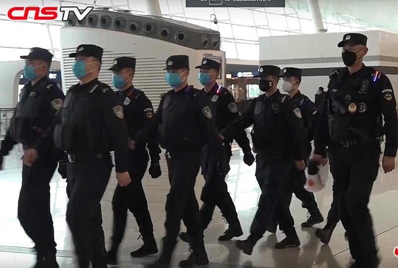 Policemen in China wearing masks in Wuhan due to the Coronavirus outbreak. photo via Wikimedia Commons under creative commons license