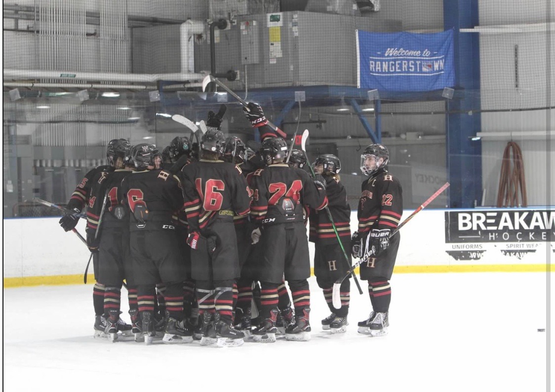 The 2019-20 Hillsborough Ice Hockey team huddles before a game.