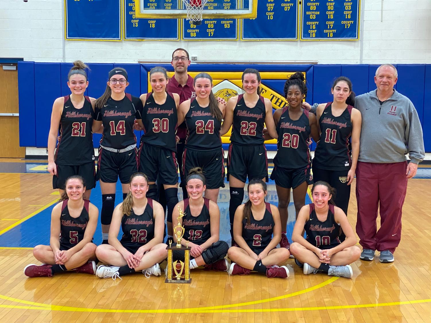 Hillsborough's Lady Raiders pose after to winning the holiday tournament.