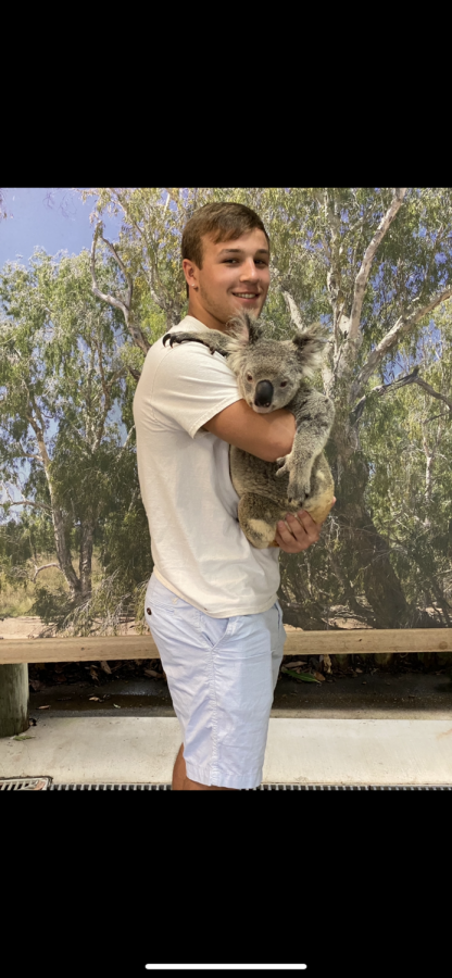 The Voice's staff writer, Sean Levonaitis, poses with a Koala