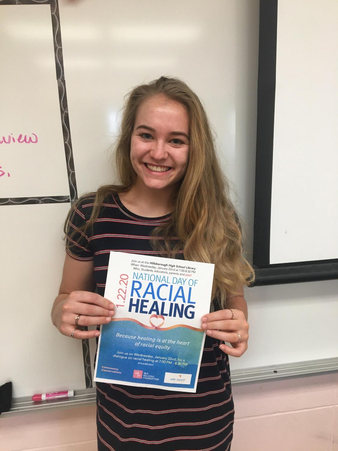 Senior Kaitlyn Dudorf holding the flyer for the Day of Racial Healing event.