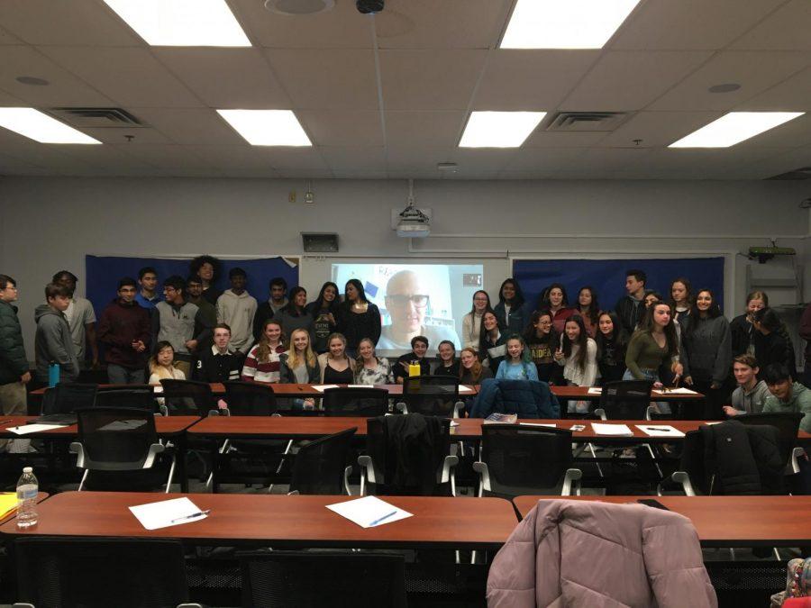 Students posed  with author Brad Stulberg