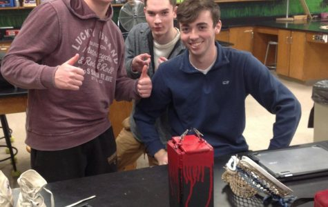 Seniors Alex Marsh, Josh Norbut, and Kyle Clark work on a project in Engineering class.