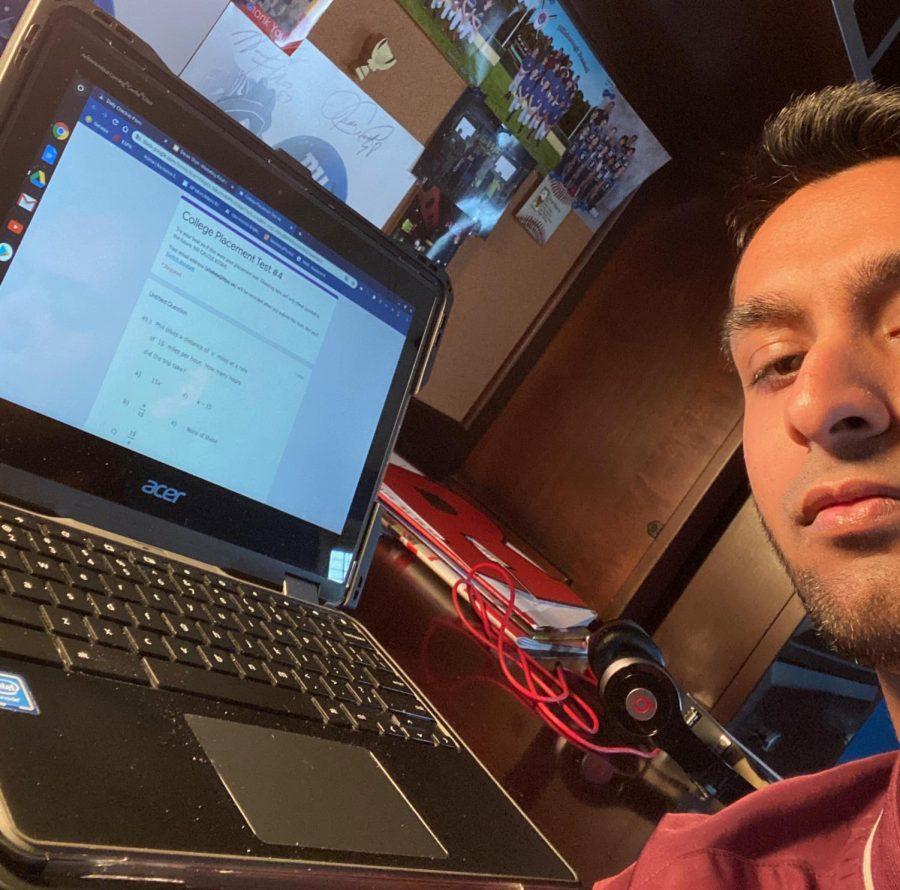 Senior+Devan+Shah+takes+a+selfie+in+his+new+%22classroom%22.