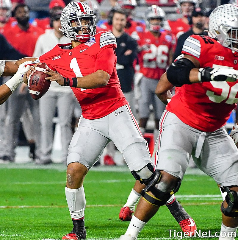 Ohio State quarterback Justin Fields prepares to launch a pass in the 2019 Fiesta Bowl.