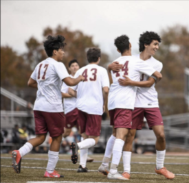 The team celebrates after the Sonbol twins connect for the 6th goal of the game against Philipsburg.