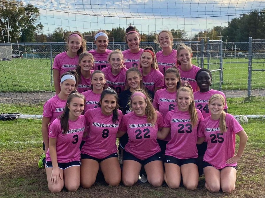 Girls+varsity+soccer+team+poses+for+their+team+photo.