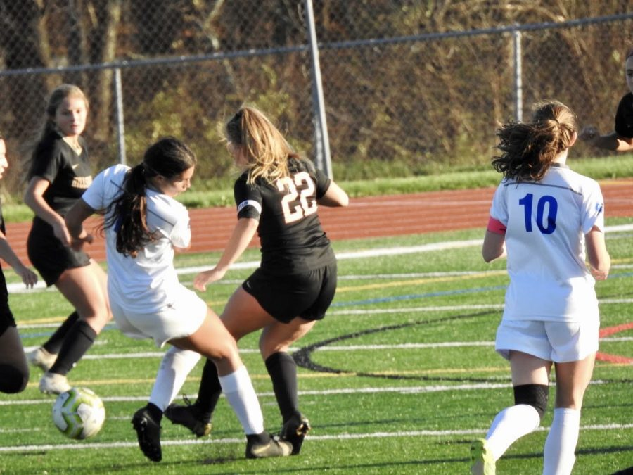 Kara+Magliaro+battles+a+Hightstown+opponent+for+possession+of+the+ball.+