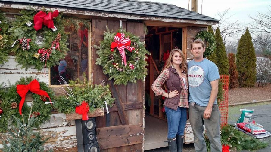 Eric Rosenthal (right) and his cashier, Anastasia Lipani (left) sell Christmas trees at a small, outdoor shop in Princeton.