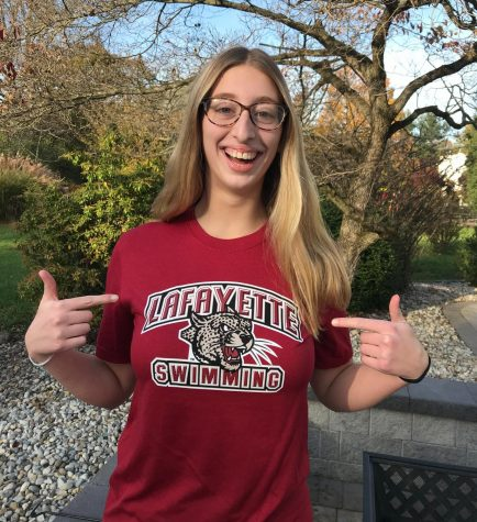 Senior Paige Griggs grins as she poses for a photo announcing her commitment to Lafayette College.