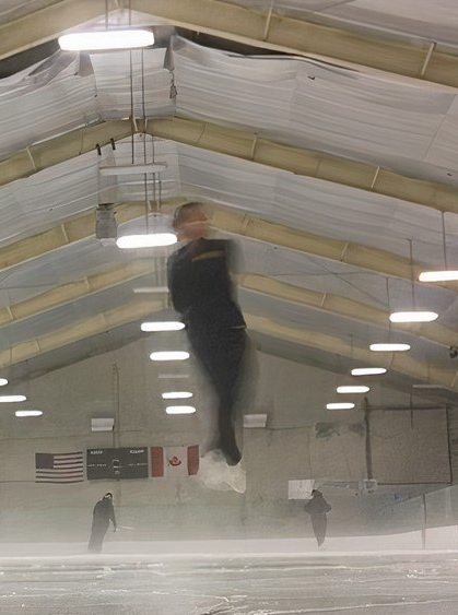 Senior Cindy Dang spins in the air over the ice.