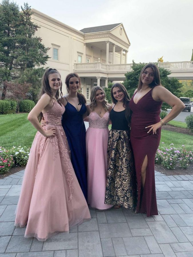 Although there was no prom last year, these high school students still took pictures with a hope of  having a prom  their senior year.